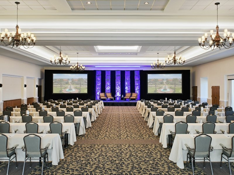 The Ponte Vedra Ballroom with a stage setup and classroom seating at Ponte Vedra Inn & Club.