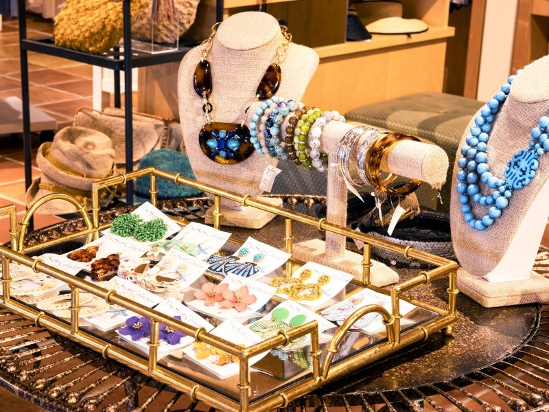 Display of various, colorful jewelry on a table