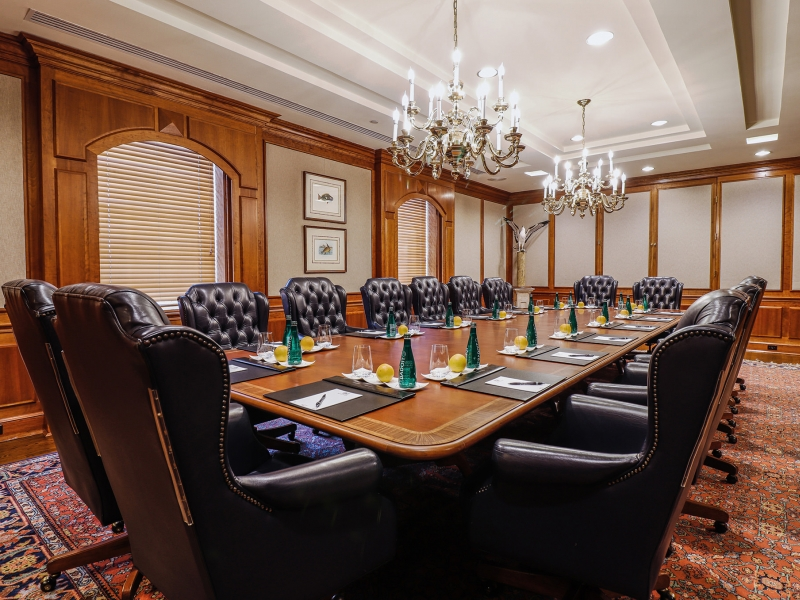 Large boardroom prepped for a meeting with luxurious leather chairs