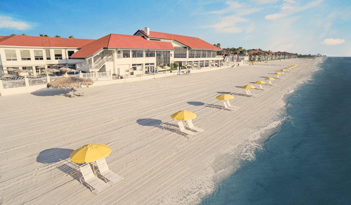 PVIC beach front with yellow umbrellas