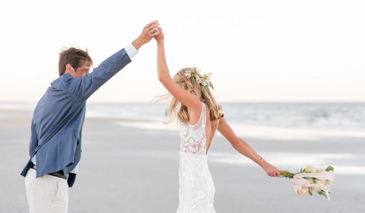 A bride and groom dance on the beach at Ponte Vedra Inn & Club.