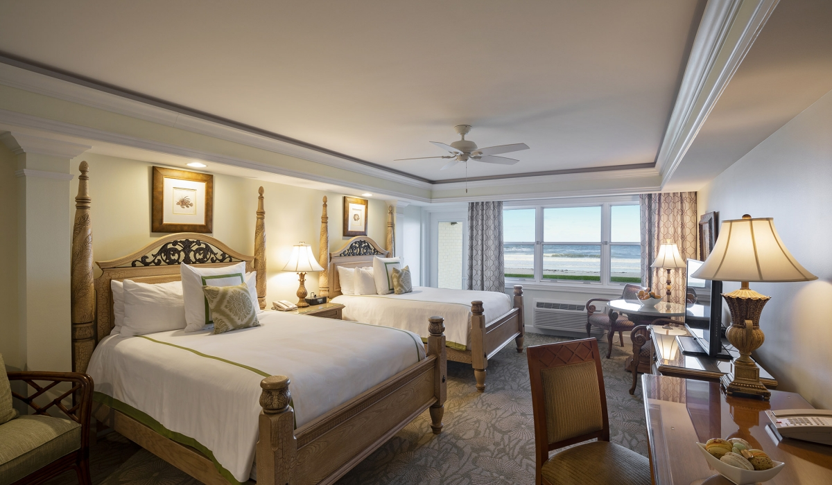 two queen beds with ocean front view