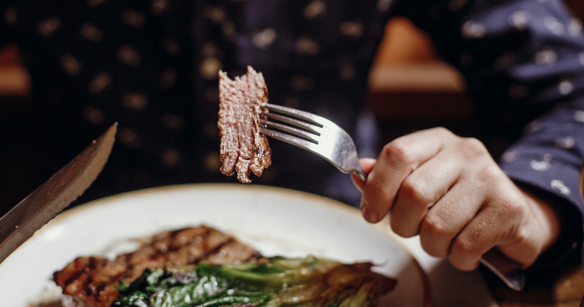 close up of man eating steak