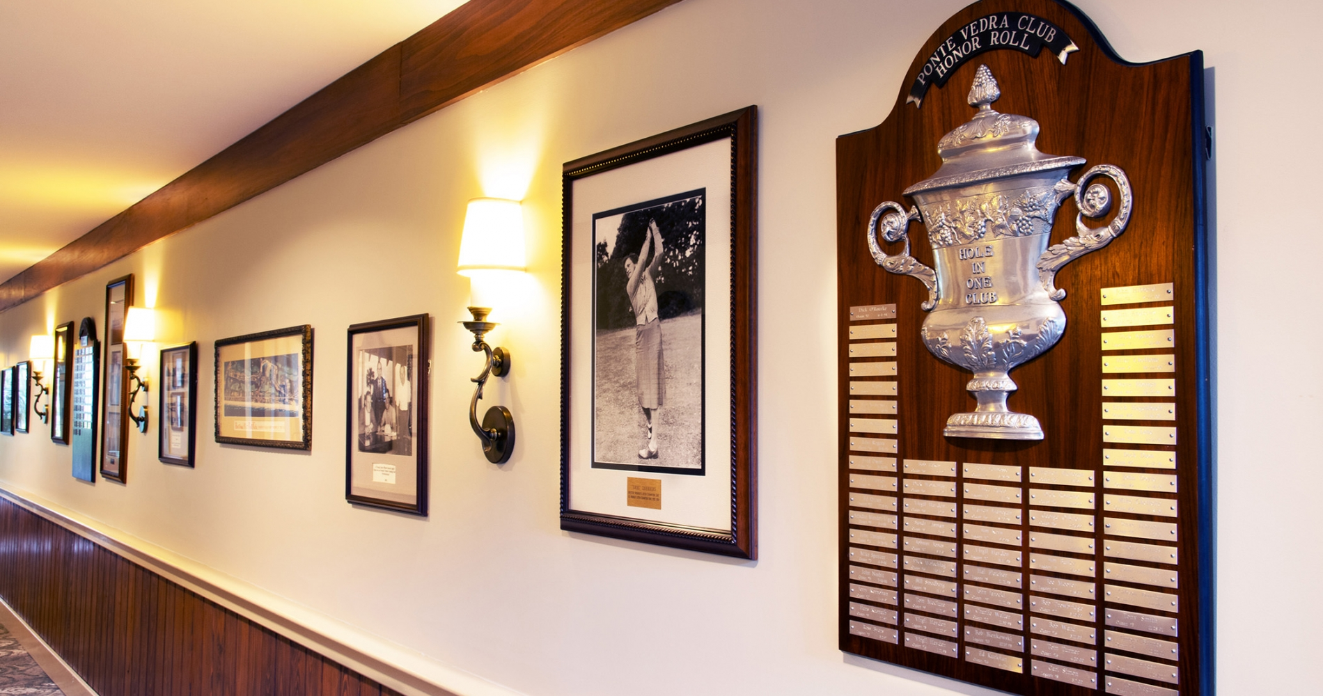 Historic golf photos and plaques on display in the club house hallway