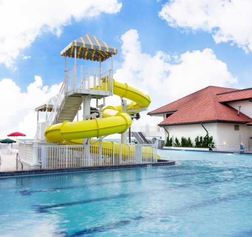 View of the yellow water slide across the kids pool at the Inn